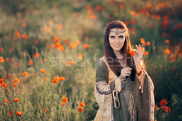Princess Pulling Petals from a Poppy Flower for Love Superstation  Stock photo © NicoletaIonescu