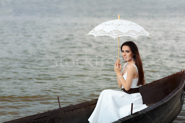 Happy Woman with Lace Parasol in an Old Wooden Boat Stock photo © NicoletaIonescu