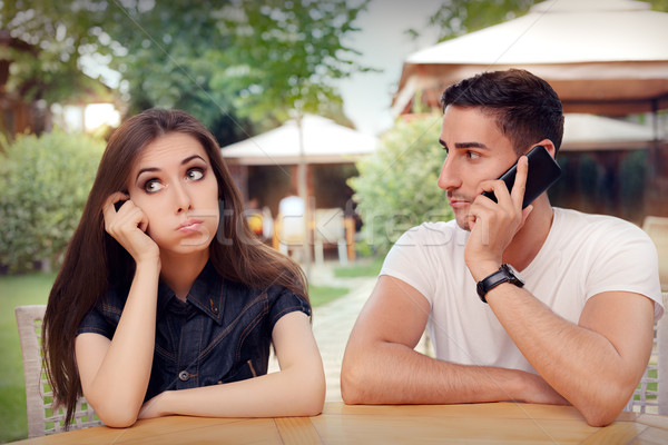 Girl Feeling Bored while her Boyfriend is on The Phone Stock photo © NicoletaIonescu