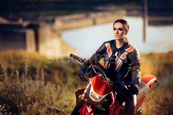 Female Motocross Racer Next to Her Motorcycle  Stock photo © NicoletaIonescu