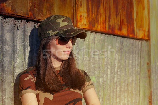 Meditative Young Woman Soldier in Camouflage Outfit Stock photo © NicoletaIonescu