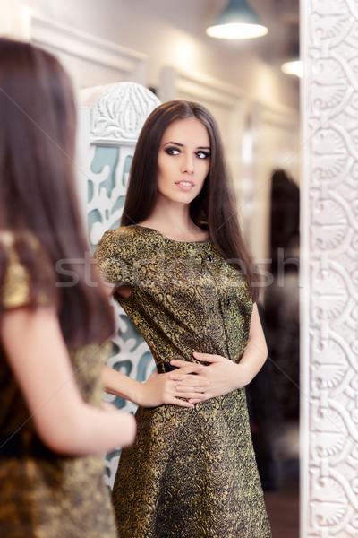 Beautiful Girl in Golden Brocade Dress Looking in the Mirror Stock photo © NicoletaIonescu