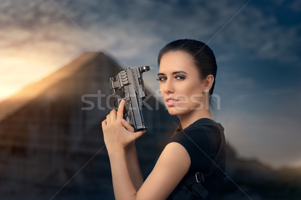 Powerful Woman Holding Gun Action Movie Style Stock photo © NicoletaIonescu
