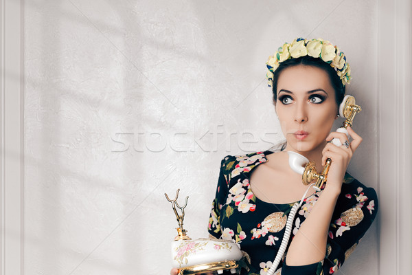 Surprised Retro Woman With Vintage Phone Stock photo © NicoletaIonescu