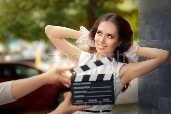 Happy Elegant Woman Ready for a Shoot Stock photo © NicoletaIonescu