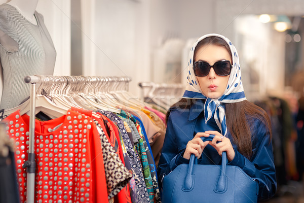 Curious Girl in Blue Trench Coat and Sunglasses Shopping  Stock photo © NicoletaIonescu