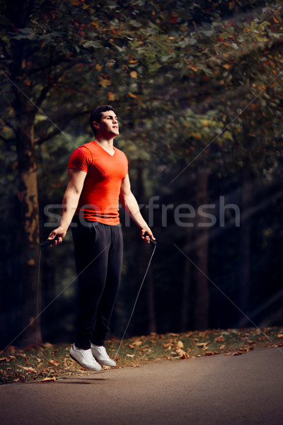 Fitness Man Skipping Rope Outdoors in Nature Stock photo © NicoletaIonescu