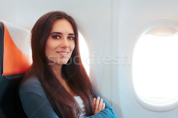 Mosolygó nő ül ablak repülőgép repülőgép érzés Stock fotó © NicoletaIonescu