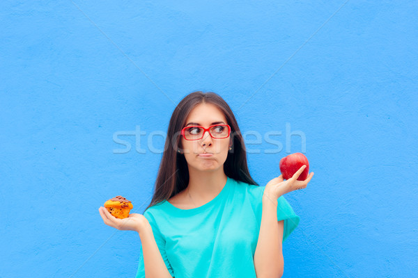 Woman Choosing Between Unhealthy Muffin and Healthy Apple Stock photo © NicoletaIonescu