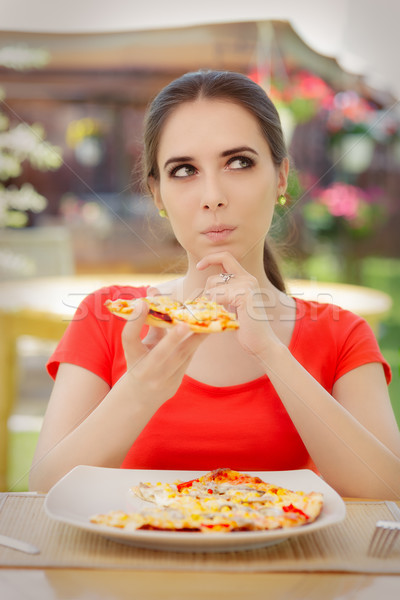 Young Woman Thinking About Eating Pizza on a Diet  Stock photo © NicoletaIonescu