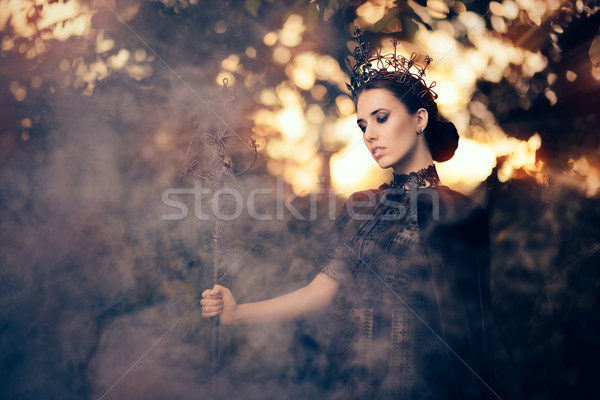 Evil Queen Holding Scepter in Misty Forest Stock photo © NicoletaIonescu