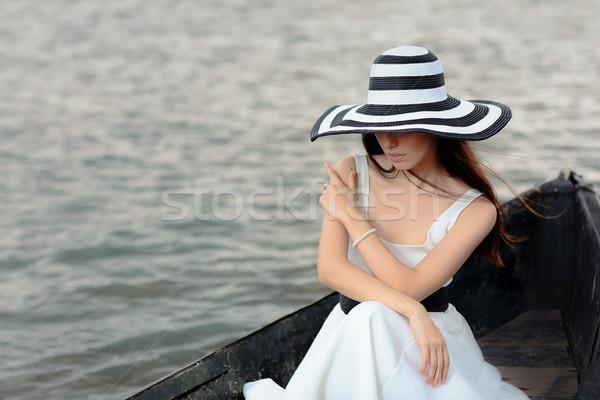 Titokzatos nő fehér ruha ül öreg csónak Stock fotó © NicoletaIonescu