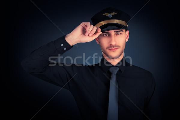Pilot Salute Low Key Portrait  Stock photo © NicoletaIonescu