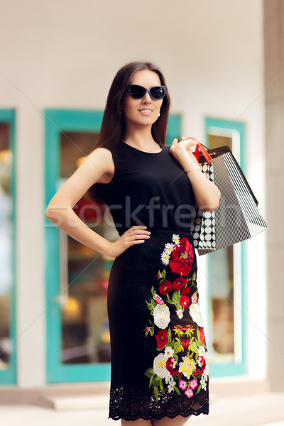 Woman with Shopping Bags in front of a Clothing Store Stock photo © NicoletaIonescu