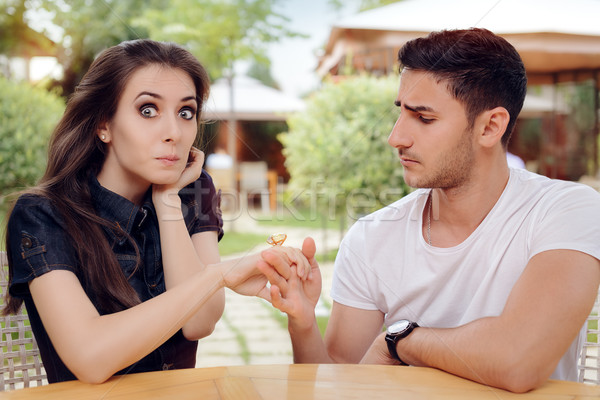 Surprised Woman Receiving Engagement Ring from Man Stock photo © NicoletaIonescu