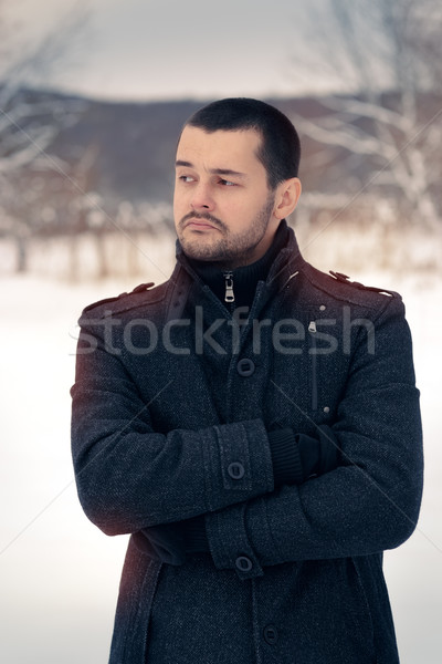 Skeptical Man Outside in Snowing Winter Decor  Stock photo © NicoletaIonescu