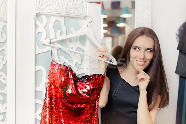 Happy Girl Trying on Red Party Dress in Dressing Room Stock photo © NicoletaIonescu