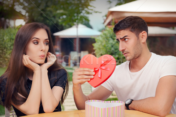 Surprised Girl Receiving Heart Shaped Gift from her Boyfriend  Stock photo © NicoletaIonescu