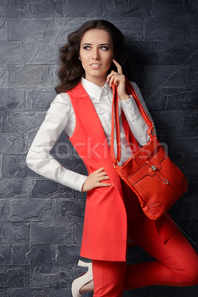 Business Woman in Smart Office Outfit with Matching Handbag Stock photo © NicoletaIonescu