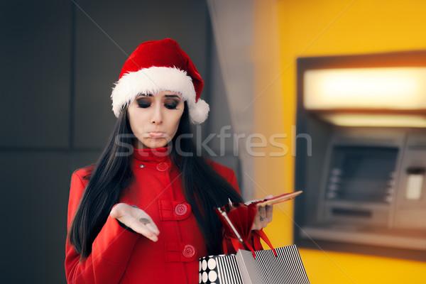 Vicces karácsony nő tart érme szomorú Stock fotó © NicoletaIonescu
