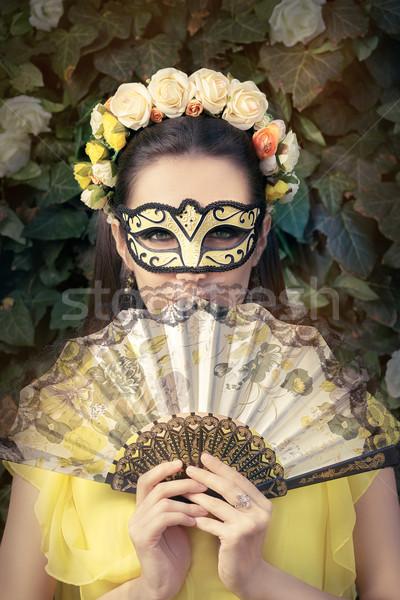 Gyönyörű nő virágmintás koszorú maszk ventillátor portré Stock fotó © NicoletaIonescu