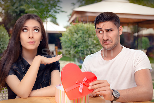Girl Refusing Heart Shaped Gift From Her Boyfriend Stock photo © NicoletaIonescu