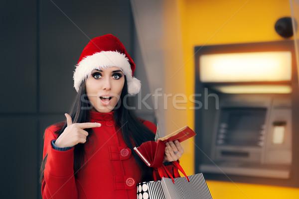 Noël femme portefeuille banque atm drôle Photo stock © NicoletaIonescu