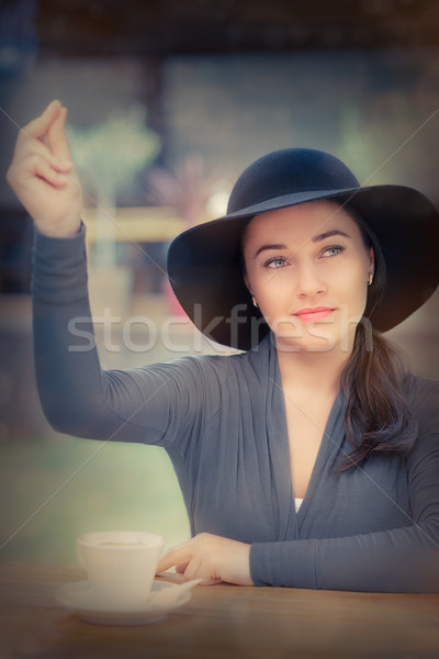 Fordern Kellner tragen hat Finger Stock foto © NicoletaIonescu