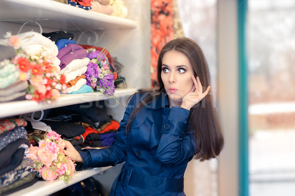 Surprised  Girl in Blue Trench Coat Shopping  Stock photo © NicoletaIonescu