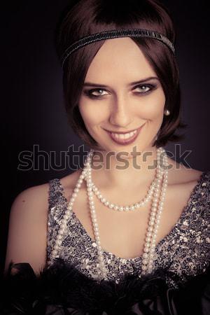 Mooie retro vrouw 20s stijl zilver Stockfoto © NicoletaIonescu