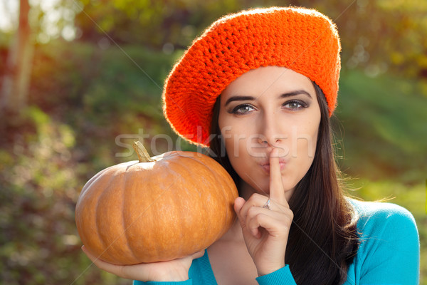 Woman with Pumpkin Holding a Secret Stock photo © NicoletaIonescu