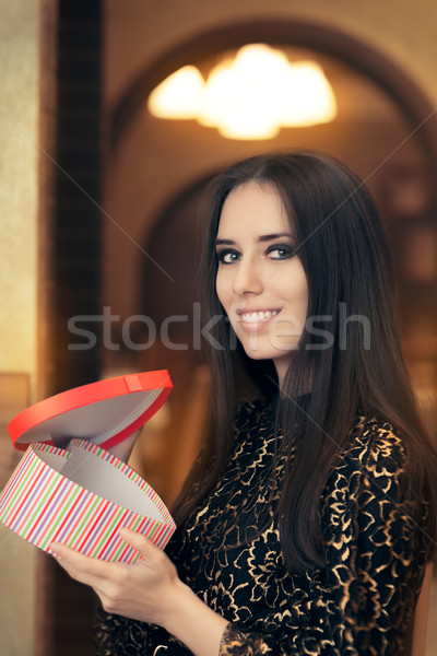 Beautiful Elegant  Woman Opening Heart Shape Gift Stock photo © NicoletaIonescu