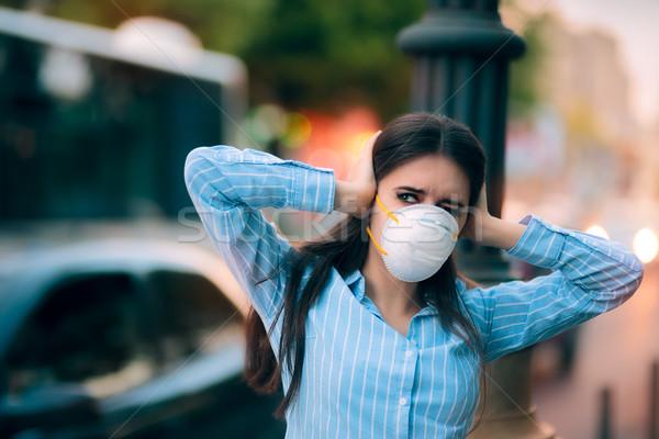 Lány maszk fülek zaj szennyezés aggódó Stock fotó © NicoletaIonescu
