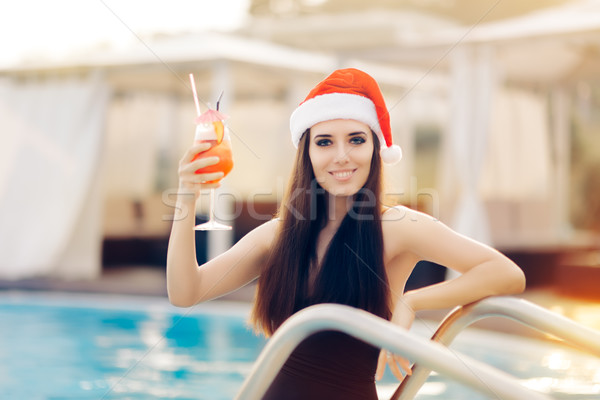 Happy Christmas Woman with Cocktail at the Pool Stock photo © NicoletaIonescu