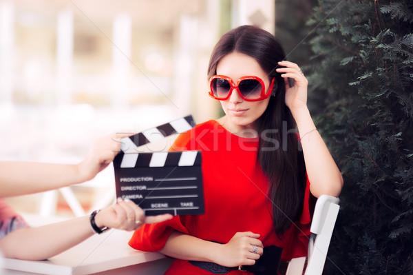 Actress with Oversized Sunglasses Shooting Movie Scene Stock photo © NicoletaIonescu