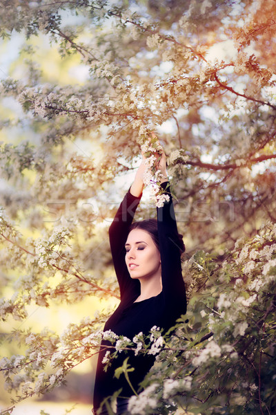 Beautiful Graceful Woman in Spring Blossom Enjoying the Flowers Stock photo © NicoletaIonescu