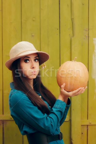 Funny Autumn Woman Holding Pumpkin Stock photo © NicoletaIonescu