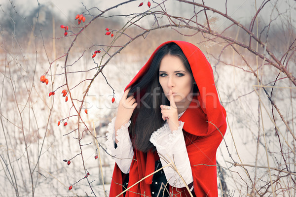 Princess Wearing Tiara and Red Cape Outside Stock photo © NicoletaIonescu