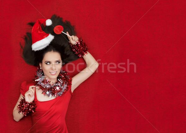 Szczęśliwy christmas dziewczyna lizak czerwony Zdjęcia stock © NicoletaIonescu
