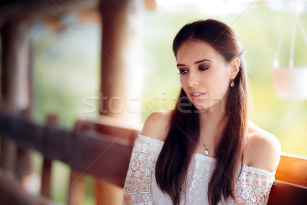 Portrait of a Melancholic Woman Wearing White Lace Top Stock photo © NicoletaIonescu