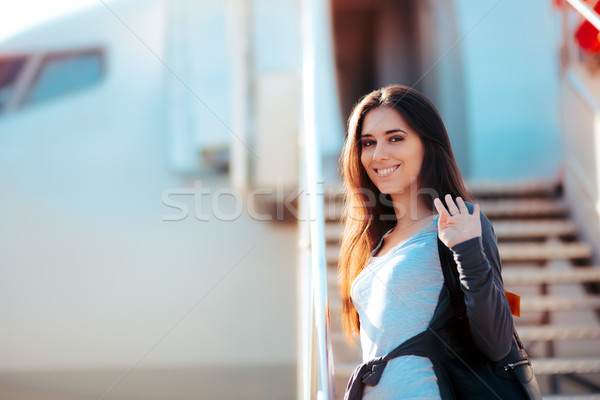 Happy Girl  Boarding  Airplane and Waving Goodbye Stock photo © NicoletaIonescu