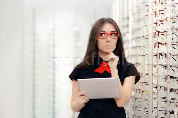 Határozatlan nő pc tabletta optikai bolt Stock fotó © NicoletaIonescu