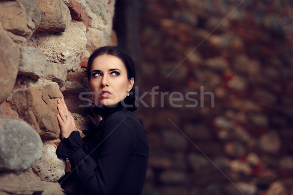 Scared Princess Near Castle Wall Stock photo © NicoletaIonescu