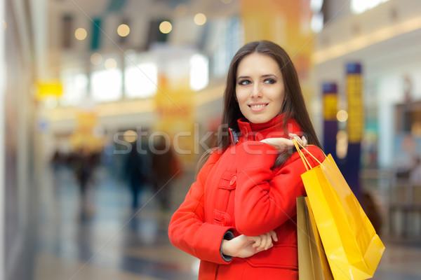 Boldog lány piros kabát pláza mosolyog divat Stock fotó © NicoletaIonescu