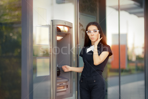Stressed Woman with credit card at ATM Stock photo © NicoletaIonescu