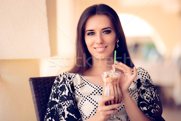 Smiling  Woman with Coffee Frappe Drink at the Restaurant Stock photo © NicoletaIonescu