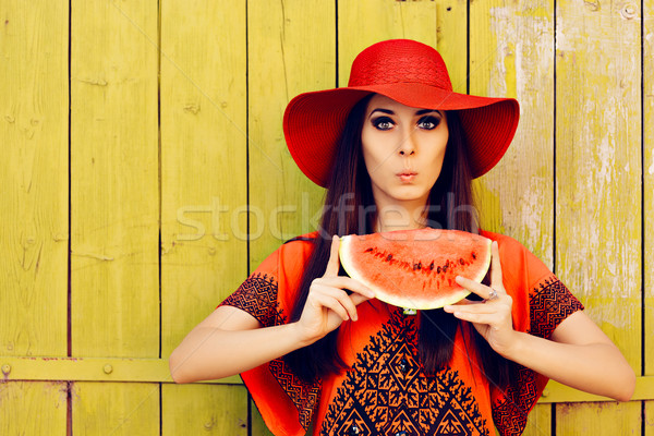 Surprised Woman in Red Hat with Watermelon Slice Stock photo © NicoletaIonescu