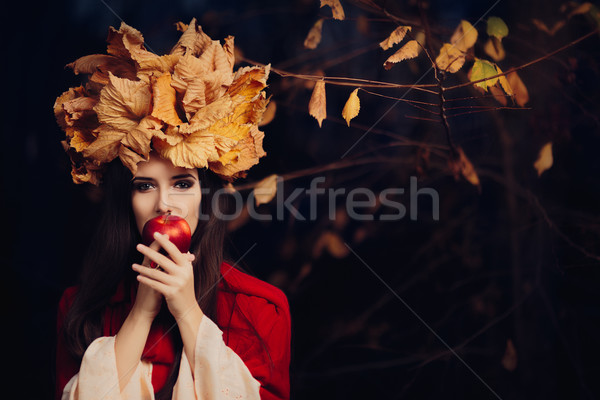 Woman With Autumn Leaves Crown Eating an Apple Stock photo © NicoletaIonescu