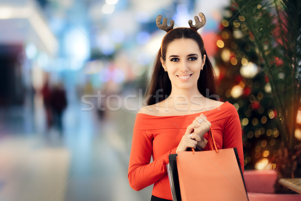 Shopping Woman Wearing Christmas Reindeer Horns Headband Stock photo © NicoletaIonescu
