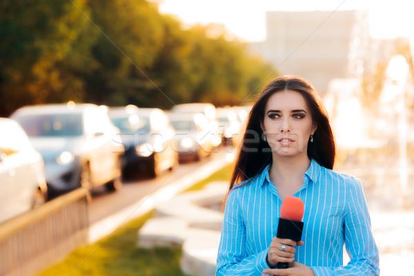 Female News Reporter on Field in Traffic  Stock photo © NicoletaIonescu